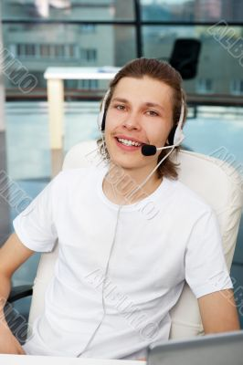 Closeup of smiling customer service executive or student with he