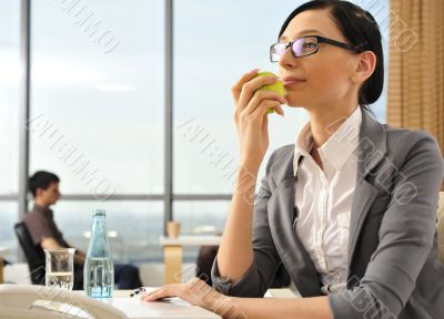 Portrait of a beautiful young businesswoman thinking.