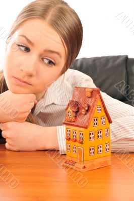 Young beautiful business woman with house model - real estate. S