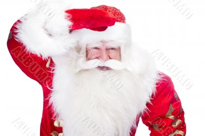 Traditional Santa Claus looking for children and holding his han