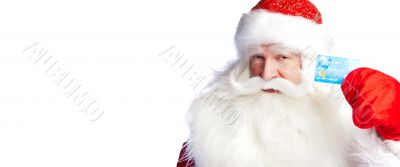 Traditional Santa Claus holding and sowing credit card while giv