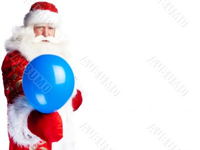 Traditional Santa Claus holding balloons for children. Isolated