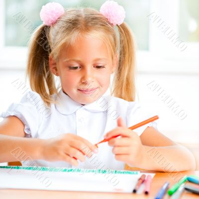 Little girl looking for a drawing concept wile painting picture