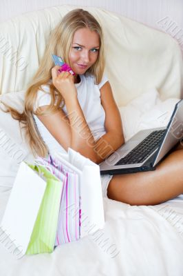 Cute online shopping girl at her home