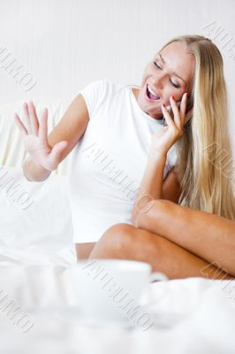 Happy young woman boasting to her friends about  her proposal ri