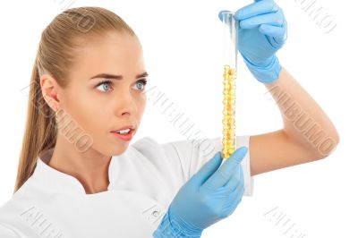 Isolated scientist woman in lab coat with chemical glassware.