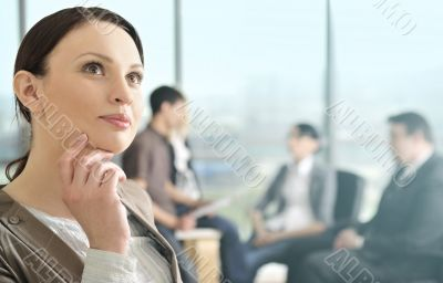 Portrait of a beautiful young businesswoman daydreaming.