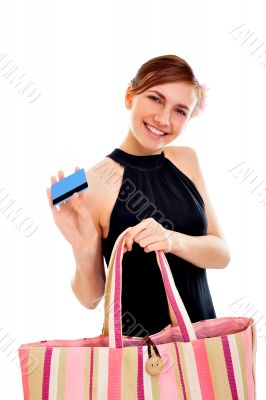 Portrait of a happy young woman woman with her handbag