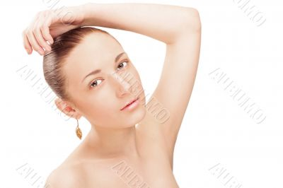 Portrait of a beautiful young woman touching her hair and lookin