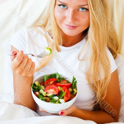 Closeup portrait of pretty caucasian woman having a healthy diet