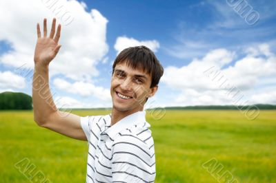 Portrait of young man taking energy from nature on vacation at c