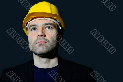 Closeup portrait of mature man wearing helmet looking far
