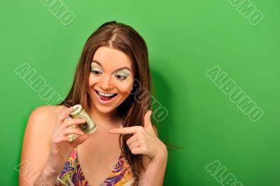 Portrait of a happy woman with a fan of American dollar