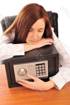 Closeup portrait of young pretty woman at her desk with deposit