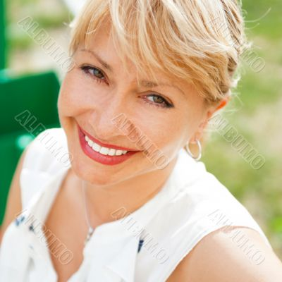 Portrait of a female smiling in a park