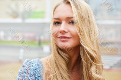 Closeup portrait of a beautiful woman in the city at summer time