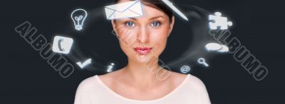 A businesswoman with icons floating around her head. Portrait of