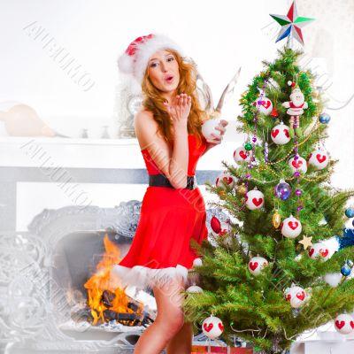 Christmas woman near a Christmas tree posing. Full length portra