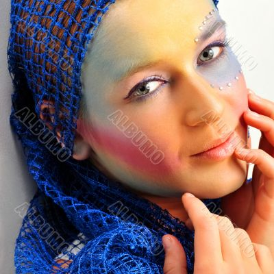 Closeup fashion portrait of cute woman with colorful bright make