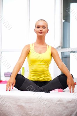 Portrait of beautiful young woman resting after doing exercise a