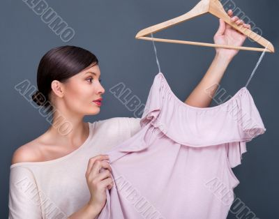 Portrait of pretty fashionable woman trying new clothes. Fashion