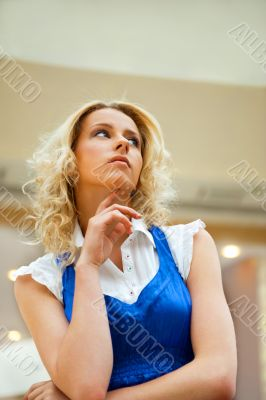A portrait of a young business woman in a hall of an office buil