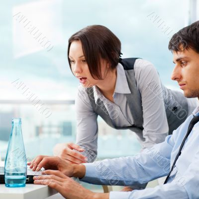 A business team of two colleagues planning work in office