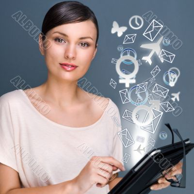 Portrait of pretty young woman holding Touch Screen tablet compu