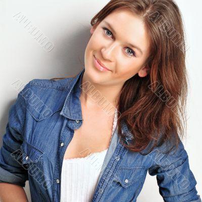 Portrait of a beautiful young woman wearing a denim shirt, tuggi