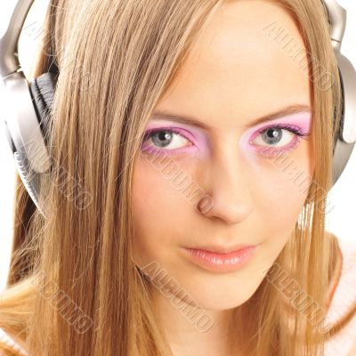 Beautiful woman with headphones, she is listening to the music