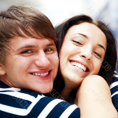 Young man meeting his girlfriend and embracing at airport arriva