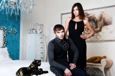 Fashion style photo of an attractive young couple inside luxury