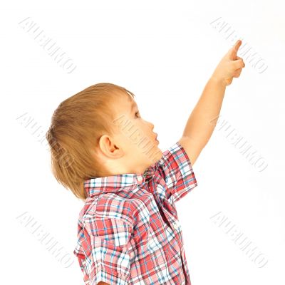 Portrait of happy little boy over white background looking away