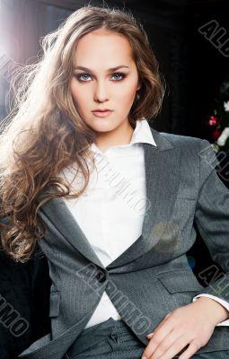 Fashion Portrait of beautiful business woman wearing luxury suit