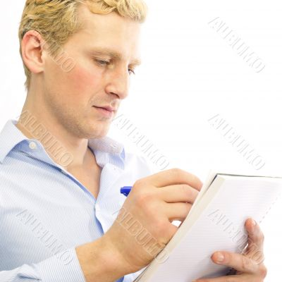 Closeup portrait of a cheerful young business man signing docume