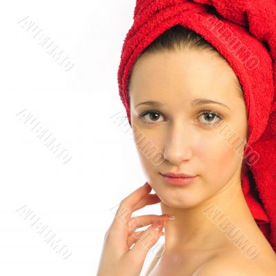 Beautiful young woman after shower with towel on her head