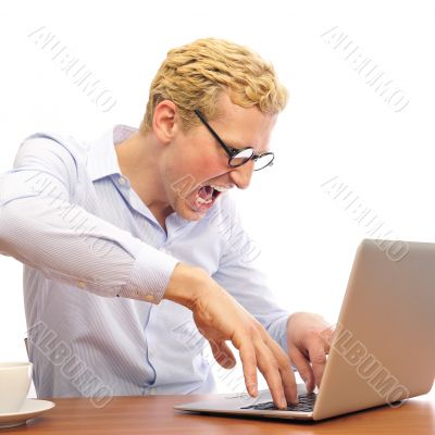 Portrait of funny man screaming during typing a document on his