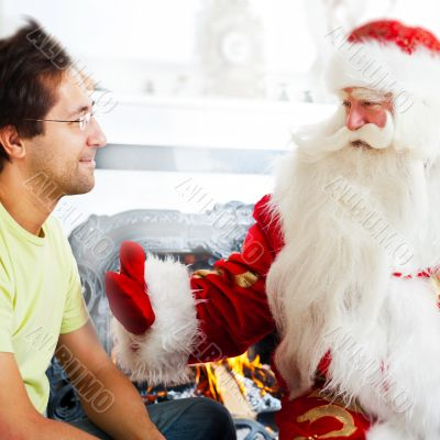 Two adult men - old father wearing Santa Claus suit and his adul