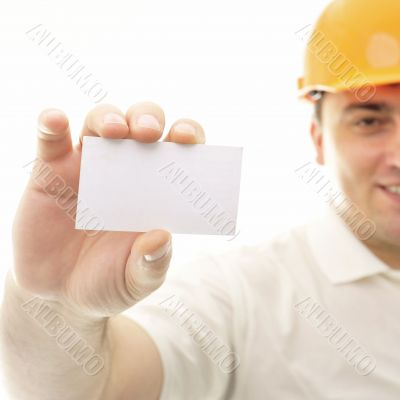 Closeup portrait of adult engineer man holding blank business ca