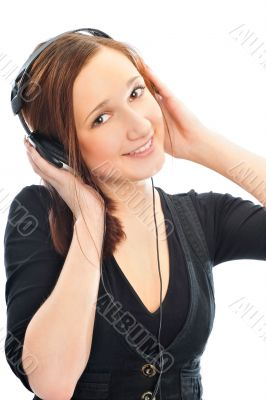 Beautiful woman with headphones, she is listen to the music
