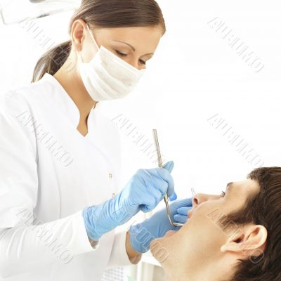 At dentist`s office - young woman dentist working