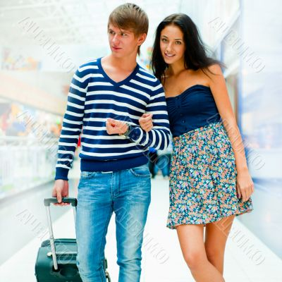 Young people tourists . At modern international airport