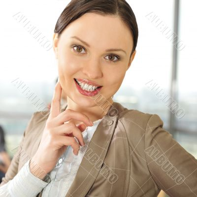 Portrait of a beautiful young businesswoman smiling at a meeting