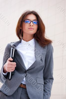 A beautiful young business woman holding her tablet personal com