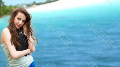 Beautiful brunette woman resting on the beach
