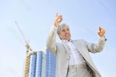 Portrait of a businessman with arms open.