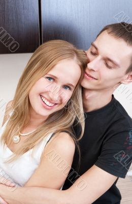 Portrait of a cute young couple enjoying themselves while prepar