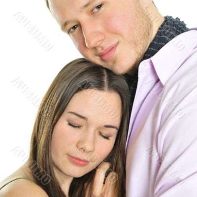 Portrait of young couple standing together and embracing