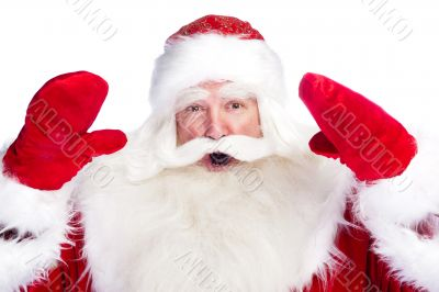 Christmas theme: Santa Claus bowing something from his arms