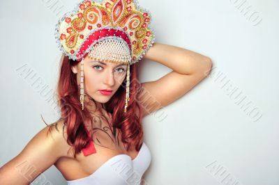Closeup portrait of pretty young woman with red hairs